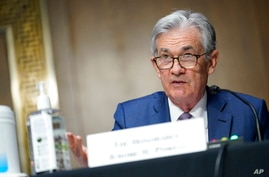 FILE - In this Dec. 1, 2020, file photo, Chairman of the Federal Reserve Jerome Powell speaks during a Senate Banking Committee…