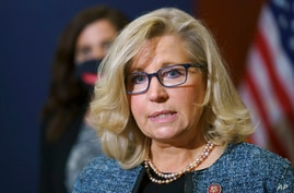 FILE - In this April 20, 2021, file photo Rep. Liz Cheney, R-Wyo., the House Republican Conference chair, speaks with reporters…