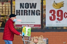 FILE - In this Friday, Jan. 8, 2021 file photo, A man walks out of a Marc's Store in Mayfield Heights, Ohio. With viral cases…