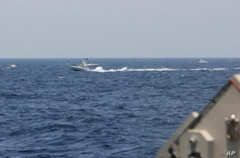 In this image provided by the U.S. Navy, an Iranian Islamic Revolutionary Guard Corps Navy (IRGCN) fast in-shore attack craft …