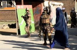 Afghan security personnel arrive at the site of a bomb explosion in Shakar Dara district of Kabul, Afghanistan, Friday, May 14,…