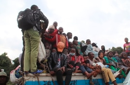 Residents flee Goma five days after Mount Nyiragongo erupted, in Congo, May 27, 2021.