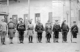 This photograph shows soldiers of the Eight-Nation Alliance in 1900, left-to-right: Britain, United States, Australian, British India, Germany, France, Austria-Hungary, Italy and Japan. (rarehistoricalphotos.com/VOA)