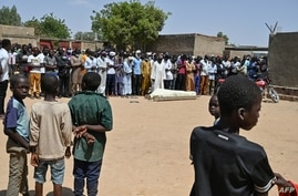 Mourners take part in a funeral ceremony for eighteen year-old Synna Garandi, in N'Djamena, May 1, 2021, after his death during a protest April 27 in the Chadian capital.
