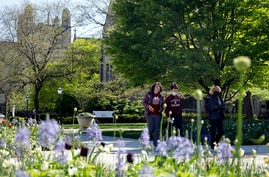 Students wearing masks make their way through the University of Chicago campus, May 6, 2021, in Chicago, Illinois.