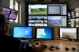 A police officer works inside the operation center at the village of Nea Vyssa near the Greek - Turkish border, Greece, May 21, 2021.