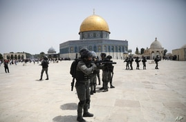 Israeli police clears Palestinians from the plaza in front of the Dome of the Rock shrine at al-Aqsa mosque complex in Jerusalem, May 21, 202, as a cease-fire took effect between Hamas and Israel after 11-day war.