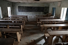 FILE - An empty classroom is seen following an attack by gunmen at a school in Kagara, Nigeria, Feb. 18, 2021. Gunmen have attacked a school in the country's north-central Niger state Sunday, according to local officials.