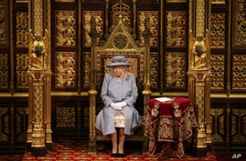 Britain's Queen Elizabeth II delivers a speech in the House of Lords during the State Opening of Parliament, at the Palace of Westminster in London, May 11, 2021.