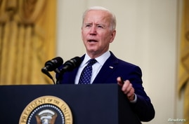 FILE - U.S. President Joe Biden delivers remarks on Russia in the East Room at the White House in Washington, April 15, 2021.