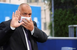 FILE - Bulgaria's then-prime minister Boyko Borissov arrives for the second day of a European Union leaders summit in Brussels, Oct. 2, 2020.