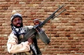 FILE - Boko Haram leader Abubakar Shekau holds a weapon at an unknown location in Nigeria in this still image taken from an undated video obtained Jan. 15, 2018.