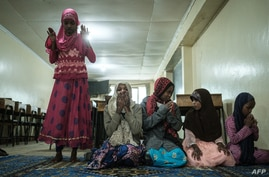 Orphans pray during the food and toy distribution, for total about 500 orphans in 11 orphanages, by National Muslim COVID-19…