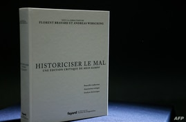 """A picture taken on June 2, 2021 in Paris, shows the new French edition of Adolf Hitler's """"Mein Kampf"""", """"Historicising Evil, A…"""