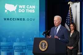 US President Joe Biden, with Vice President Kamala Harris, speaks on Covid-19 response and vaccinations in the South Court…