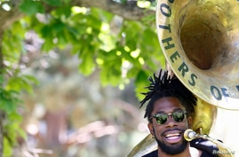 Khalil Brass, of the Brothers of Brass band, performs with his sousaphone at an event to mark Juneteenth, which commemorates…