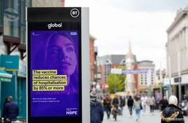 An advert is seen amid the spread of the coronavirus disease (COVID-19), in Leicester, Britain, May 27, 2021. REUTERS/Andrew…