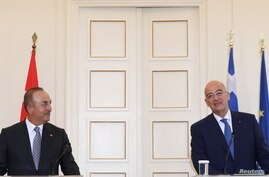 Greek Foreign Minister Nikos Dendias and his Turkish counterpart Mevlut Cavusoglu attend a news conference at the Ministry of Foreign Affairs in Athens, Greece, May 31, 2021.