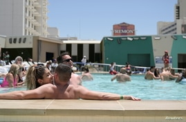 Lisa Castello and Wes Bailey relax at the pool at Circa Resort and Casino on Memorial Day in Las Vegas, Nevada, May 31, 2021.