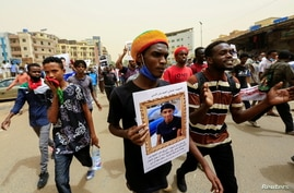 Sudanese take part in a march against the Rapid Support Forces, who they blame for a raid on protesters who had camped outside…