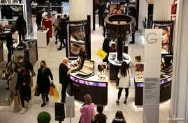 FILE PHOTO: People shop in the Selfridges department store on Oxford street, as the coronavirus disease (COVID-19) restrictions…