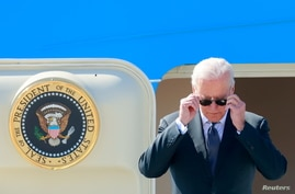 U.S. President Joe Biden steps off Air Force One at Cointrin airport as he arrives ahead of a meeting with Russian counterpart…
