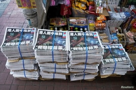 Copies of the final edition of Apple Daily, published by Next Digital, are seen at a newsstand in Hong Kong, China June 24,…