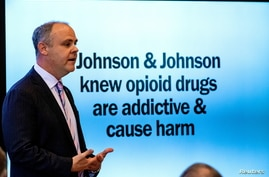 FILE - State's attorney Brad Beckworth presents information in the opening statements during the Oklahoma v. Johnson & Johnson opioid trial at the Cleveland County Courthouse in Norman, Oklahoma, May 28, 2019.