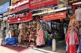 Shops in a Delhi market gear up to open, June 7, 2021, after a devastating second wave shut the city for nearly two months.