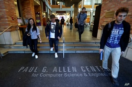 FILE - Students walk out of the Paul G. Allen School of Computer Science & Engineering at the University of Washington in Seattle.