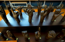 A sculpture of hands signing the alphabet is seen at Gallaudet University museum in Washington, Wednesday, Dec. 11, 2019. …
