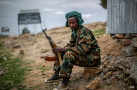 A fighter loyal to the Tigray People's Liberation Front mans a guard post on the outskirts of the town of Hawzen, then…