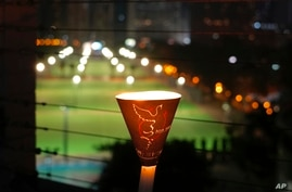 A candle is displayed near Hong Kong's Victoria Park, June 4, 2021, in Hong Kong.