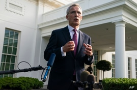 NATO Secretary General Jens Stoltenberg talks to reporters after meeting with President Joe Biden at the White House, Monday,…