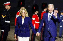U.S. President Joe Biden and first lady Jill Biden arrive on Air Force One at Cornwall Airport Newquay, near Newquay, England,…