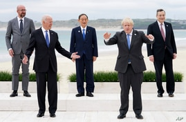 Leaders of the G7 pose during a group photo at the G7 meeting at the Carbis Bay Hotel in Carbis Bay, St. Ives, Cornwall.