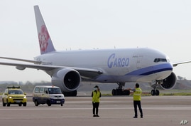 In this photo released by the Taiwan Centers for Disease Control, a China Airlines cargo plane carrying COVID-19 vaccines from…