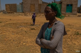 Letay Girmay, 50, says she and other Hawzen residents buried the bodies of many civilians after  battles in Hawzen, Ethiopia, on June 6, 2021(VOA/Yan Boechat)