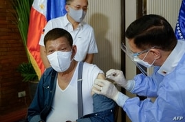 FILE - This handout photo taken May 3, 2021, and received from the Presidential Photo Division May 4, 2021, shows Philippine President Rodrigo Duterte receiving a dose of China's Sinopharm COVID vaccine at Malacanang Palace in Manila.