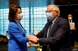 European Union Foreign Policy Chief Josep Borrell (R) greets Belarusian opposition leader Sviatlana Tsikhanouskaya prior to a EU foreign ministers meeting, in Luxembourg, June 21, 2021.