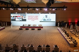 FILE - Qatar's Minister of Foreign Affairs Sheikh Mohamad Bin Abdel Rahman Al-Thani delivers a speech during the opening session of the peace talks between the Afghan government and the Taliban in the Qatari capital Doha, Sept. 20, 2020.