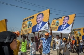 Supporters hold banners of candidates during a rally of the opposition Waddani Party for Somaliland's elections in Hargeisa, the capital of the self-declared republic of Somaliland in northern Somalia, May 25, 2021.