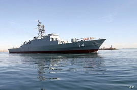 In this photo provided Saturday, Dec. 1, 2018, by the Iranian Army, The new Iranian destroyer Sahand sails in Persian Gulf…