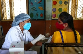 A health worker administers the Covishield vaccine during a special vaccination drive against COVID-19 in Hyderabad, India,…