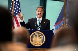 FILE - New York Gov. Andrew Cuomo speaks about the lifting of COVID-19 restrictions during a news conference at One World Trade in New York, June 15, 2021.