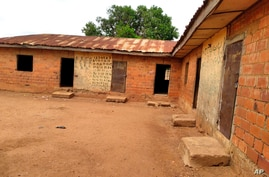 FILE - A school stands empty after the abduction days earlier of its students, in Tegina, Nigeria, June 1, 2021. Kidnappers last week targetted a school in the remote town of Birnin Yauri in northwest Nigeria's Kebbi state.