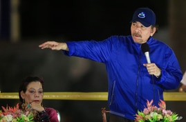 FILE - Nicaragua's President Daniel Ortega speaks next to first lady and Vice President Rosario Murillo during a ceremony in Managua, Nicaragua, March 21, 2019.
