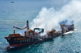 This photo provided by Sri Lanka's Air Force shows the sinking MV X-Press Pearl at Kapungoda where it was anchored off Colombo port, Sri Lanka, June 2, 2021.