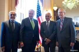 From left, Afghan reconciation chief Abdullah Abdullah, U.S. Senate Majority Leader Chuck Schumer, Afghan President Ashraf Ghani, and U.S. Senate Minority Leader Mitch McConnell, pose for a photo on Capitol Hill in Washington, June 24, 2021.