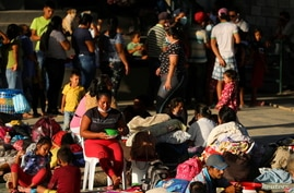 Venezuelan migrants are seen inside a coliseum where a temporary camp has been set up in Arauquita, Colombia, March 27, 2021.